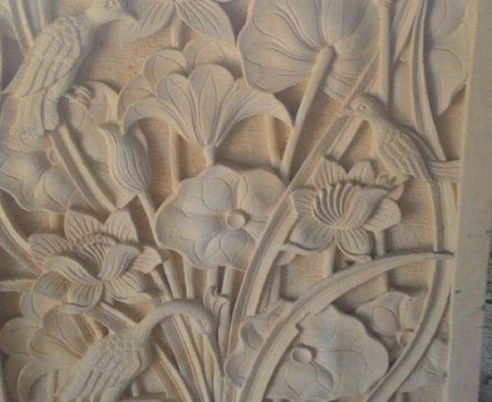 Relief motif bunga burung