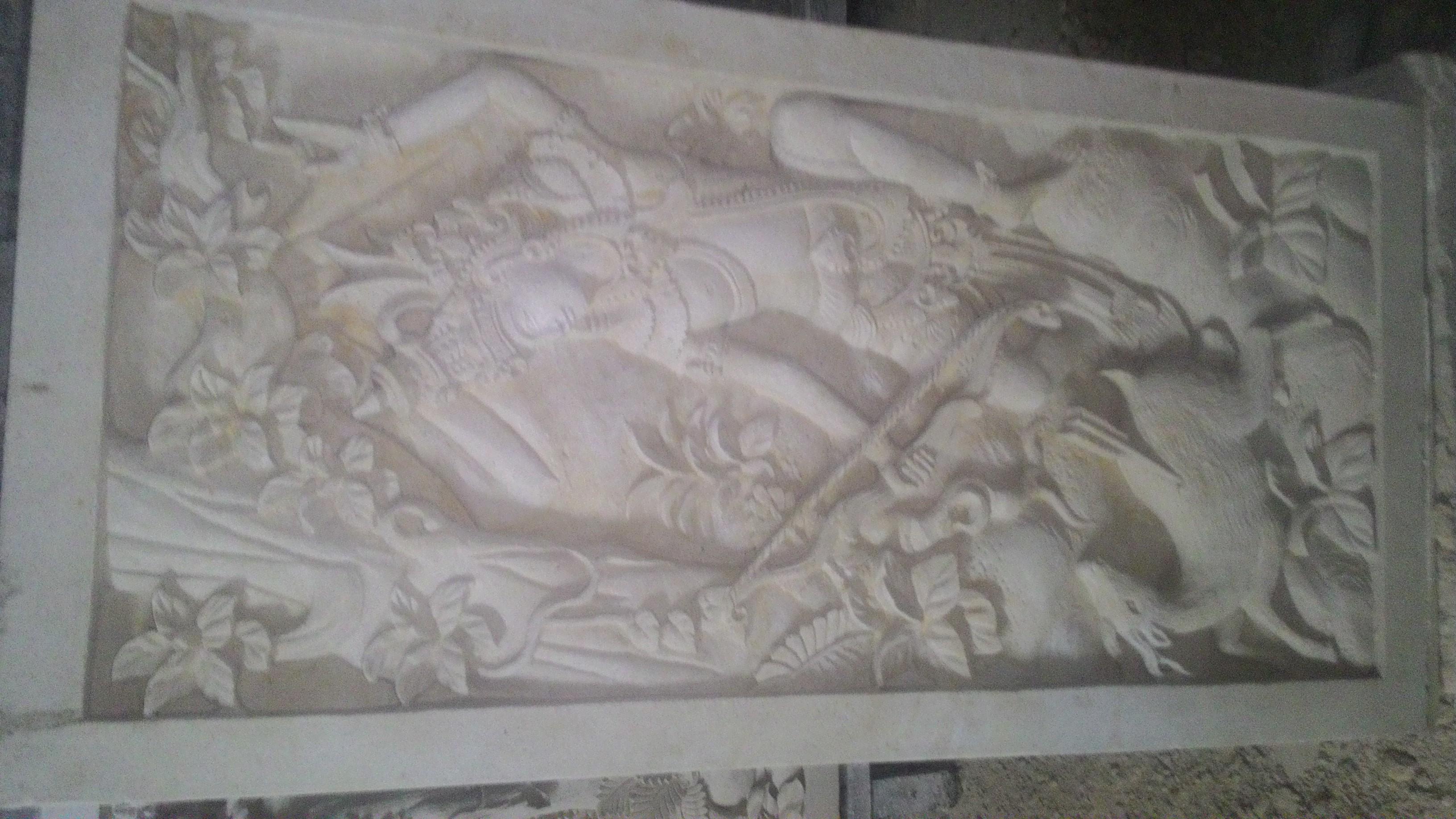 Releif dinding rumah motif Ramayana